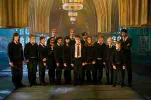 """(L-r) RYAN NELSON as Slightly Creepy Boy, NICK SHRIM as Somewhat Doubtful Boy, BONNIE WRIGHT as Ginny Weasley, SHEFALI CHOWDHURY as Parvati Patil, OLIVER PHELPS as George Weasley, AFSHAN AZAD as Padma Patil, KATIE LEUNG as Cho Chang, JAMES PHELPS as Fred Weasley, DANIEL RADCLIFFE as Harry Potter, MATTHEW LEWIS as Neville Longbottom, EMMA WATSON as Hermione Granger, RUPERT GRINT as Ron Weasley, EVANNA LYNCH as Luna Lovegood, WILLIAM MELLING as Nigel and ALFRED ENOCH as Dean Thomas in Warner Bros. Pictures' fantasy """"Harry Potter and the Order of the Phoenix."""" PHOTOGRAPHS TO BE USED SOLELY FOR ADVERTISING, PROMOTION, PUBLICITY OR REVIEWS OF THIS SPECIFIC MOTION PICTURE AND TO REMAIN THE PROPERTY OF THE STUDIO. NOT FOR SALE OR REDISTRIBUTION"""