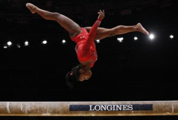 Simone Biles of the U.S competes on the beam during the women's all-round final at the World Gymnastics Championships in Glasgow